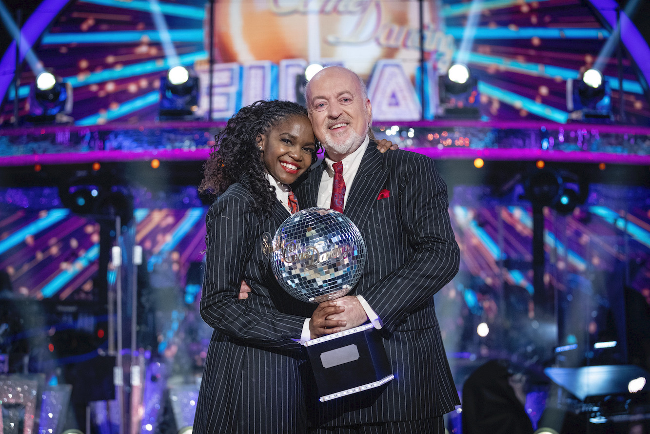 Bill and Oti lift the litter ball trophy in 2020