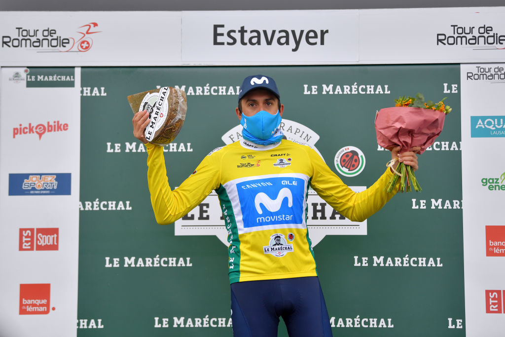 ESTAVAYER SWITZERLAND APRIL 30 Marc Soler Gimenez of Spain and Movistar Team Yellow Leader Jersey celebrates at podium during the 74th Tour De Romandie 2021 Stage 3 a 1687km stage from Estavayer to Estavayer Cheese Trophy Mask Covid safety measures Flowers TDR2021 TDRnonstop UCIworldtour on April 30 2021 in Estavayer Switzerland Photo by Luc ClaessenGetty Images