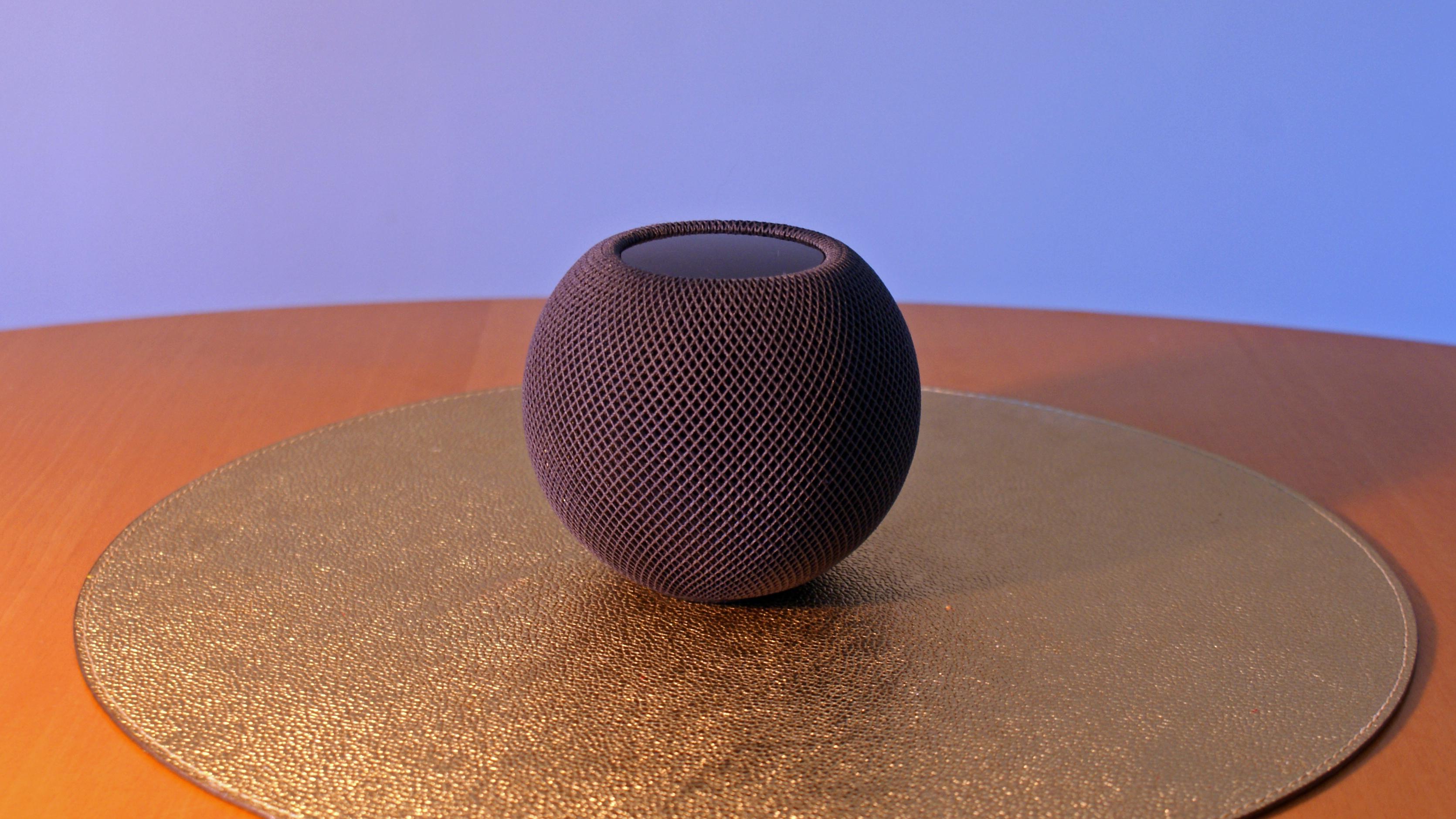 A HomePod mini on a table