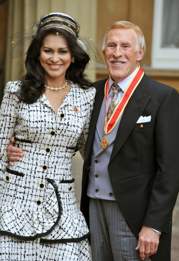 Sir Bruce Forsyth with his wife Wilnelia after being knighted by Queen Elizabeth II.