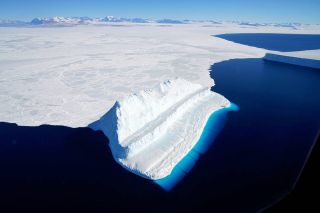 An image from NASA's ice-surveying mission shows an iceberg floating in Antarctica's McMurdo Sound.
