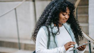 Best PDF editors: Woman using phone