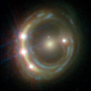 In this Hubble Space Telescope view of the distant quasar RXJ1131-1231, a foreground galaxy smears the image of the background quasar into a bright arc (left) and creates a total of four images — a phenomenon known as gravitational lensing.