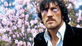 Jim Capaldi with flower petals on his eyes