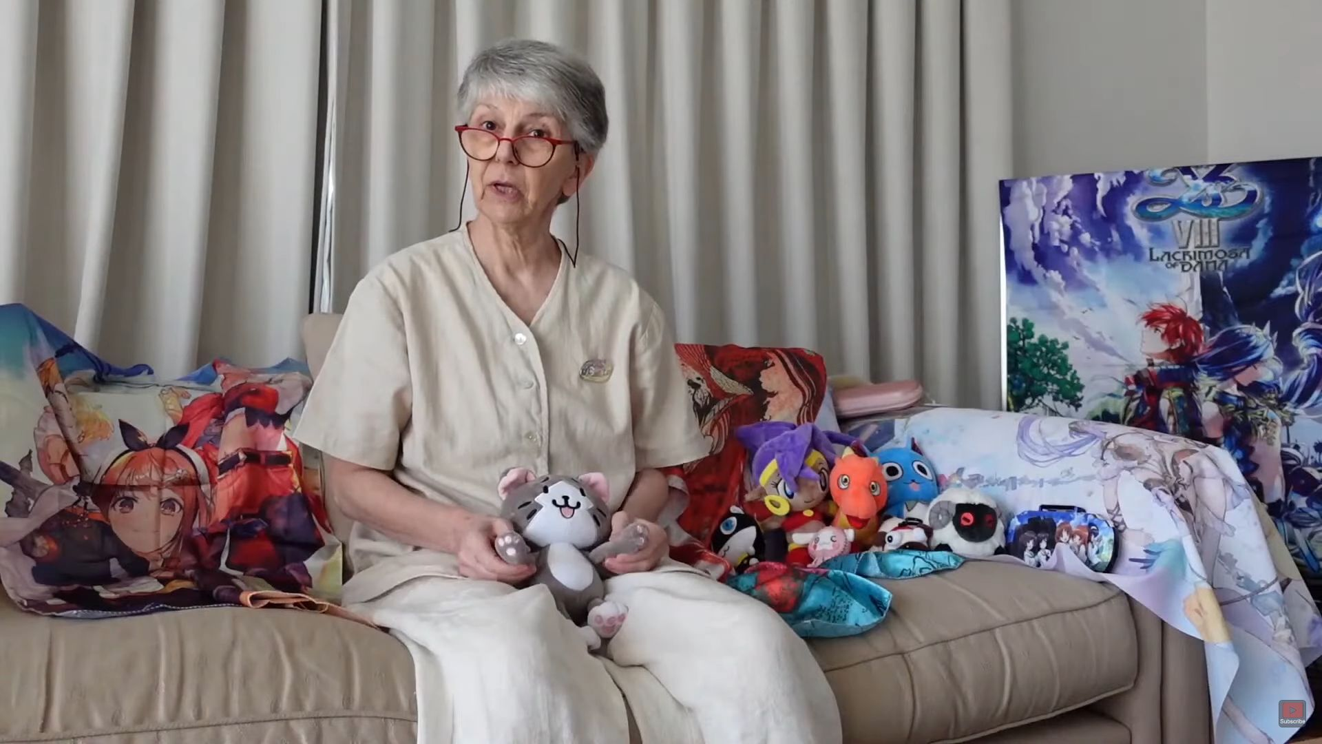 Dame Britta, surrounded by her anime merchandise