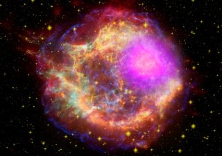 Gamma rays (magenta) blast out of the Cassiopeia A supernova remnant in this composite satellite image. New research suggests the most mysterious gamma-ray bursts in the universe may form in a similar way.