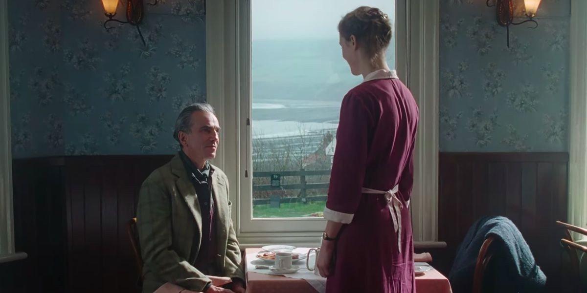 Daniel Day-Lewis sitting down
