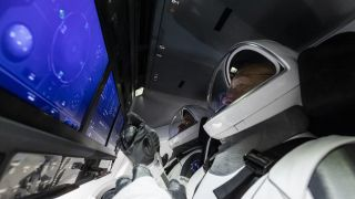 NASA astronauts Doug Hurley and Bob Behknen perform a launch dress rehearsal inside their SpaceX Crew Dragon spacecraft