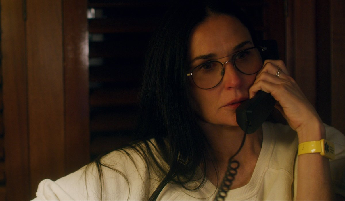 Songbird Demi Moore makes a phone call in the study