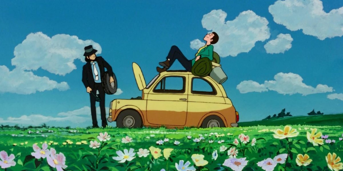 Lupin sitting on a car in Lupin The Third: The Castle of Cagliostro