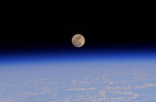 xpedition 42 Sees Full Moon Setting
