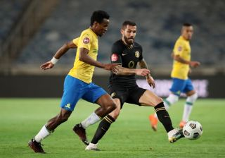 Daniel Cardoso challenging Themba Zwane for the ball