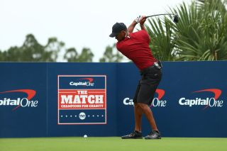 Tiger Woods plays his shot from the seventh tee during The Match: Champions For Charity at Medalist Golf Club on May 24, 2020 in Hobe Sound, Florida.