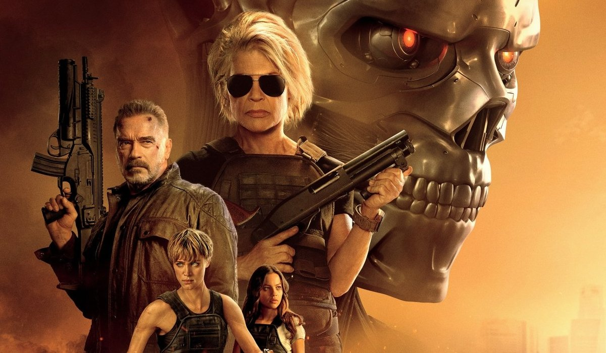 Terminator Dark Fate cast lineup in an orange tinged sky