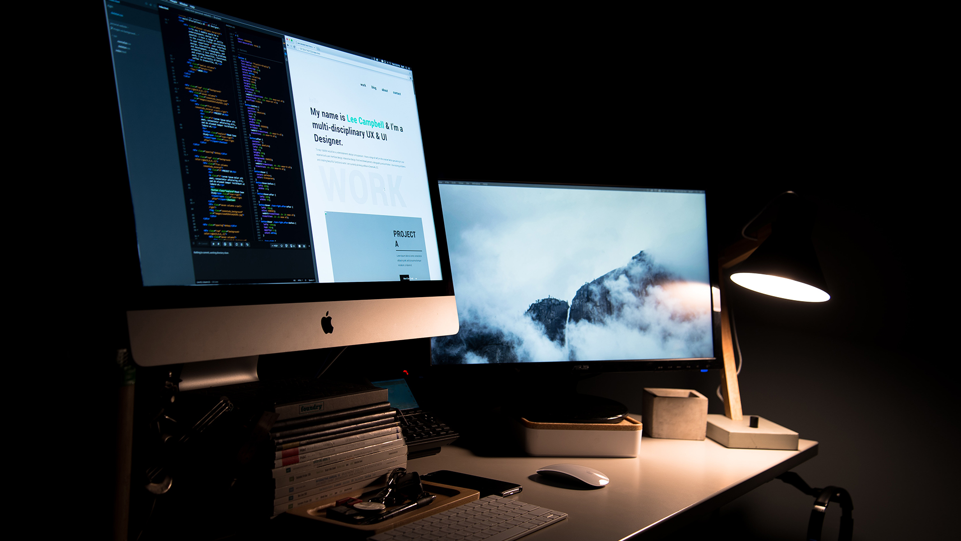 two screens on a desk showing different webpages