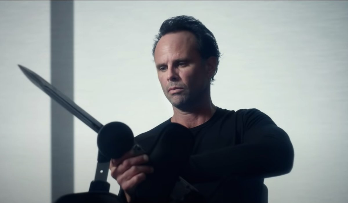 Fatman Walton Goggins examines his leg mounted blade