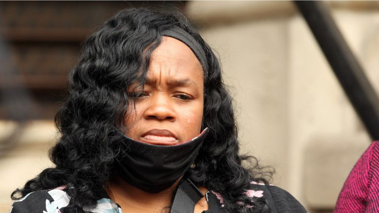 LOUISVILLE, KY - AUGUST 13: Breonna Taylor's mother Tamika Palmer listens during a press conference over the speed of the investigation of her daughter's death as attorney Benjamin Crump and co-counsel Lonita Baker addresses the media outside Louisville City Hall on August 13, 2020 in Louisville, Kentucky.The attorneys and family are upset with the lack of action by city officials during the 150 days since Breonna Taylor was fatally shot by Louisville Metro Police officers. (Photo by John Sommers II/Getty Images)