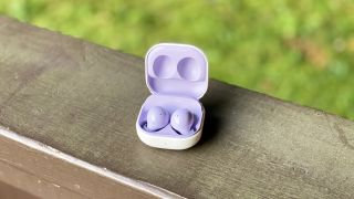 the samsung galaxy buds 2 wireless earbuds in their charging case