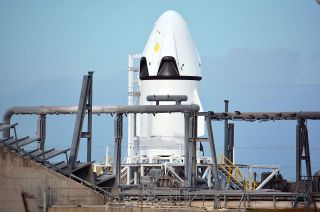 SpaceX's Crew Dragon stands poised for its first flight test, a pad abort from Cape Canaveral's Launch Complex 40.