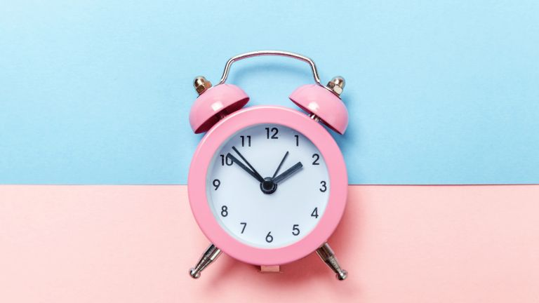 why can't I sleep: pink alarm clock on blue and pink background