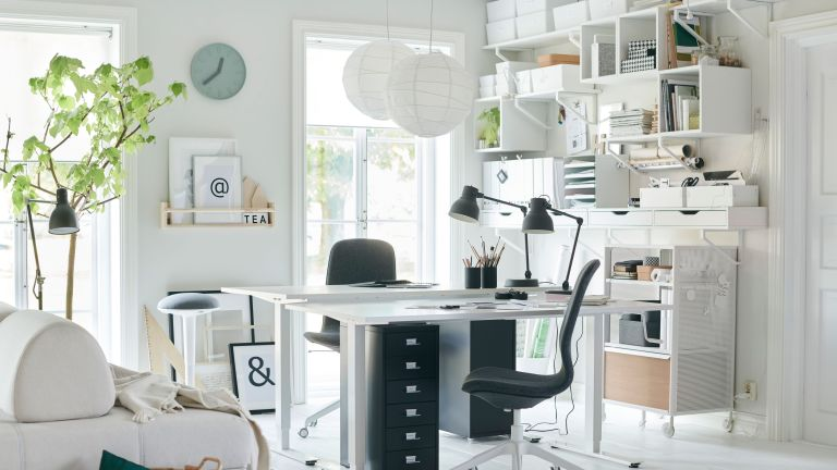 home office with white spacious scheme, two central desks and lots of handy storage solutions by ikea