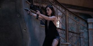 Ana de Armas aiming her guns very angrily in No Time To Die.
