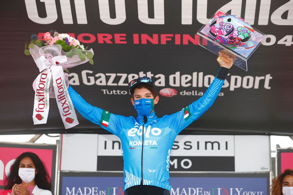Team EOLO Kometa Cycling Team rider Italys Lorenzo Fortunato celebrates on the podium after winning the 14th stage of the Giro dItalia 2021 cycling race 205km between Citadella and Monte Zoncolan on May 22 2021 Photo by Luca Bettini AFP Photo by LUCA BETTINIAFP via Getty Images