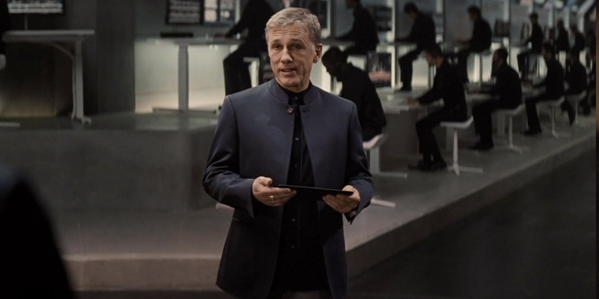 Christoph Waltz holds a tablet, standing in the middle of his control room, in Spectre.