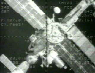 ISS Commander Manually Docks Cargo Ship at Space Station