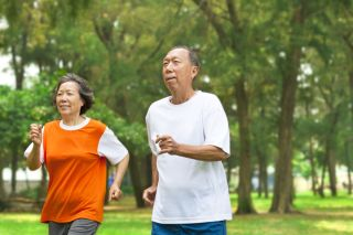 An older couple jogs together