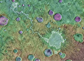 An image colored based on elevation shows Parana Basin, which scientists believe was once a lake. The white valley is one researchers believe formed from a catastrophic breach; the black valleys are ones scientists believe formed by other mechanisms.