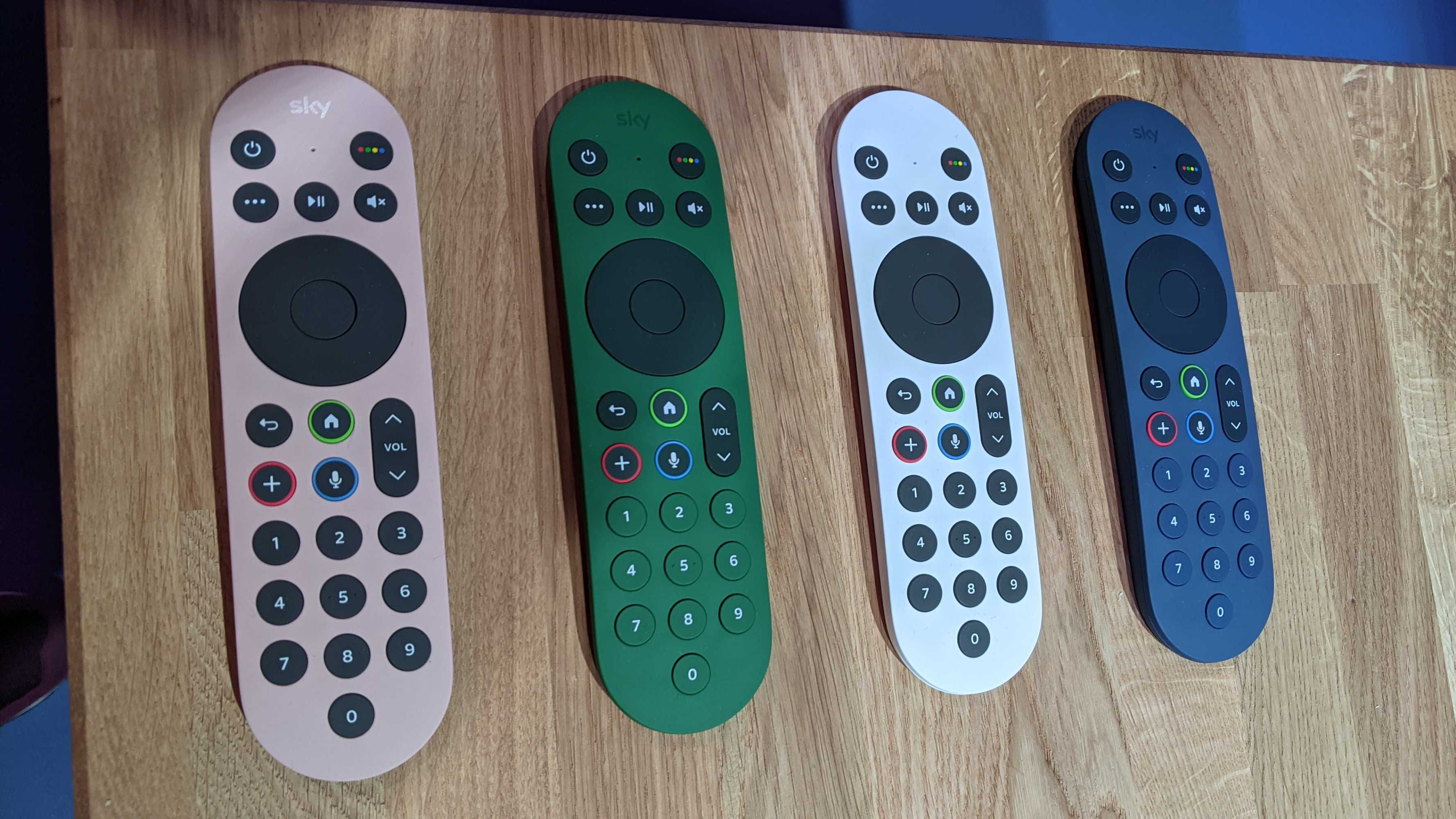 sky glass remotes along table in four different colors