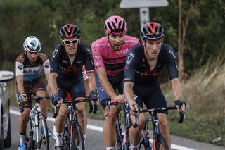 Geraint Thomas rides behind his Ineos teammates