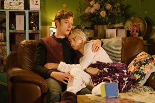 Sinead and Daniel hug on sofa Coronation Street