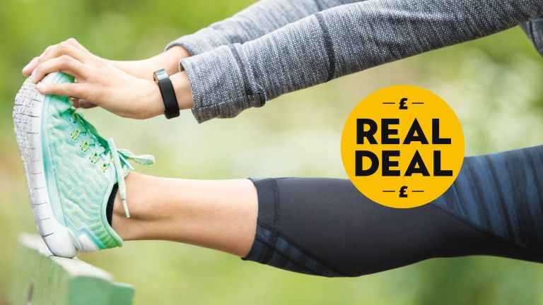 Fitbit on lady's wrist while stretching