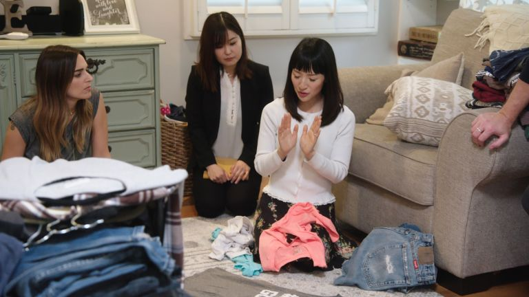 Marie Kondo helping a woman to organize clothes