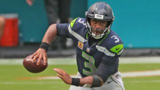 Seattle Seahawks quarterback Russell Wilson scrambles against the Miami Dolphins on Sunday, Oct. 4, 2020 in Miami Gardens, Florida. He'll look to keep his team undefeated against the Vikings.