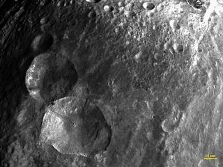 Vesta has snowman craters