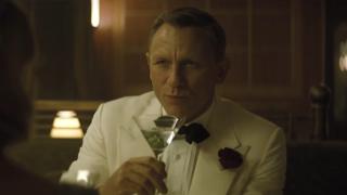 Daniel Craig sipping a martini
