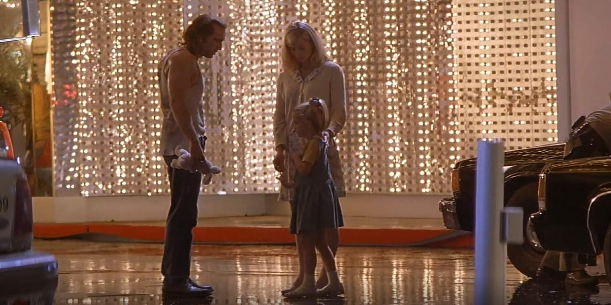Nicolas Cage, Monica Potter, and Landry Allbright in Con Air