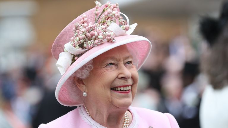 Queen Elizabeth II meets guests as she attends the Royal Garden Party at Buckingham Palace on May 29, 2019 in London, England