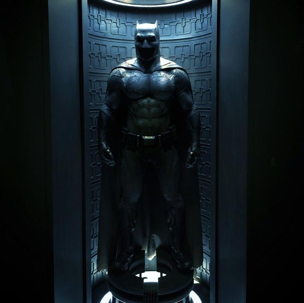 Image result for bruce wayne looking at bat suit