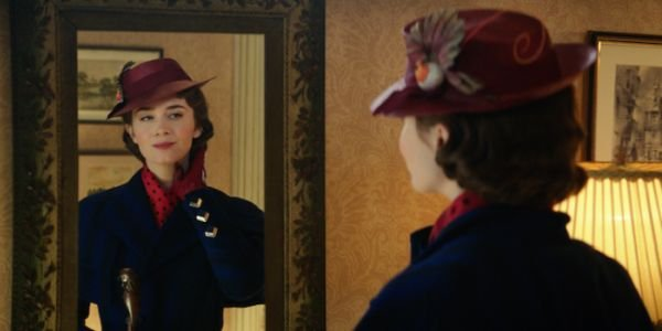 Emily Blunt looking in a mirror in Mary Poppins Returns