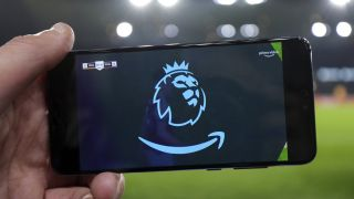 WOLVERHAMPTON, ENGLAND - DECEMBER 04: The Premier League and Amazon Prime logo on a mobile telephone showing the match live via the internet during the Premier League match between Wolverhampton Wanderers and West Ham United at Molineux on December 4, 2019 in Wolverhampton, United Kingdom. (Photo by James Baylis - AMA/Getty Images)
