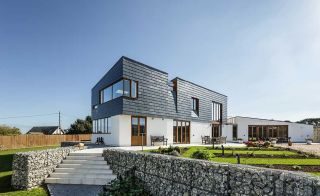 Contemporary cladding and render on selfbuild