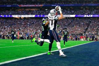 Rob Gronkowski of the New England Patriots catches a touchdown pass on a natural-grass turf against K.J. Wright of the Seattle Seahawks during the Super Bowl on Feb. 1, 2015 in Glendale, Arizona.