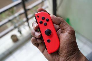 Nintendo Switch Joy-Con being held