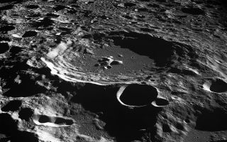An oblique view of the Daedalus Crater on the far side of the moon, as seen from the Apollo 11 spacecraft in lunar orbit.