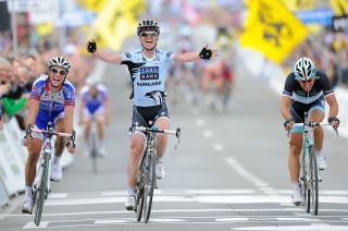 Nick Nuyens wins the 2011 Tour of Flanders from Sylvain Chavanel and Fabian Cancellara.
