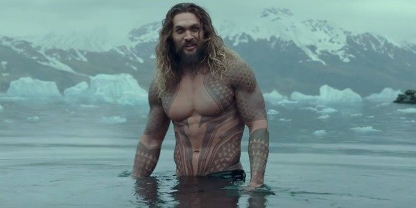 Momoa, shirtless, in the freezing water